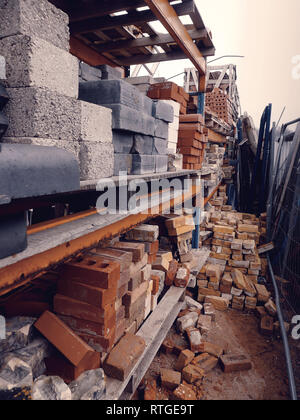 Stacks of various reclaimed bricks at a salvage yard in the UK. - Stock Photo
