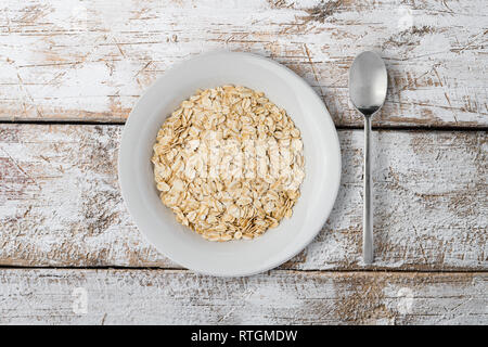 white plate with oat braids on white background - Stock Photo