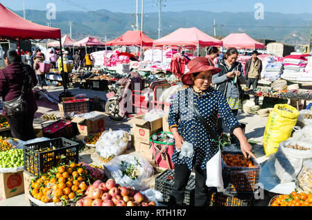 Outdoor fruits stall at Friday Market in Shaxi, Yunnan province, China - Stock Photo