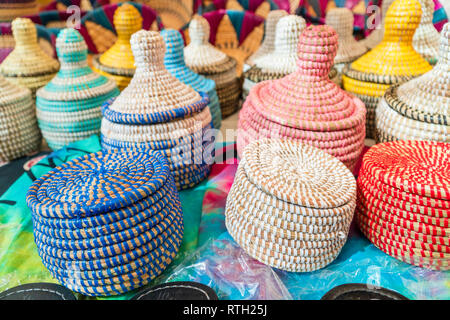 Handmade colorful wicker baskets on open air market in Morro Jable, Fuerteventura, Spain - Stock Photo