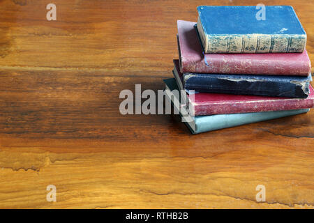 Old Books on a Wooden Table - Stock Photo