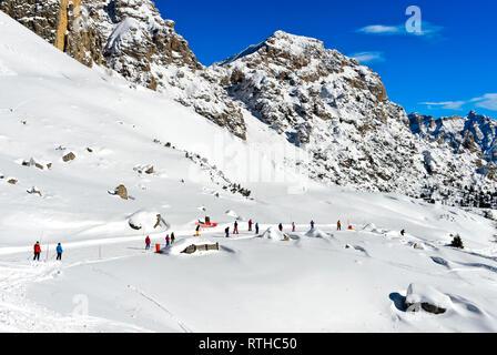 Skiers in the skiing area Colfosco, Alta Badia, Corvara, South Tyrol, Italy - Stock Photo