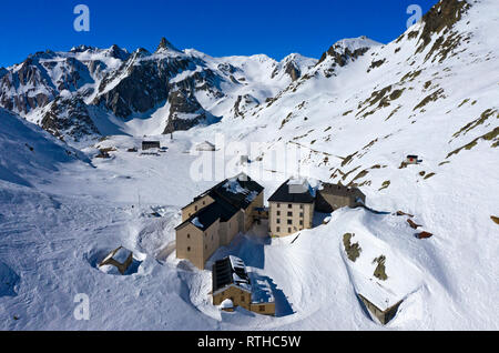 The hospice on the Great St. Bernhard Pass in winter, aerial shot, Bourg-St-Pierre, Valais, Switzerland - Stock Photo