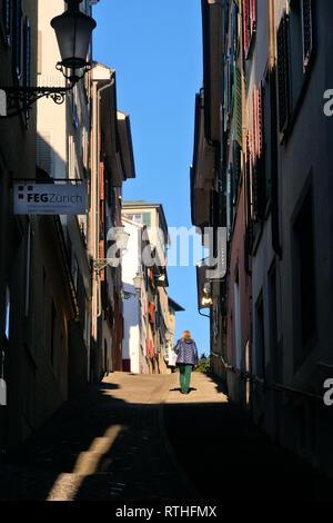 Passantin auf einer Treppe durch die ZŸricher Altstadt. - Stock Photo