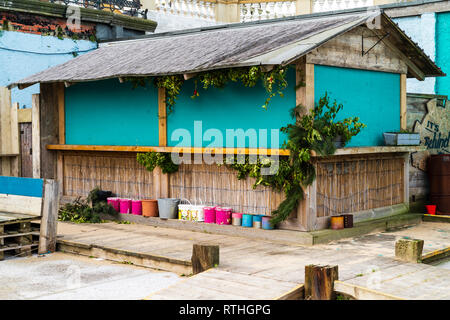 Margate seaside resort. Boarded beach bar during the winter, off season time. Wooden hut building with green boards in place of open windows. - Stock Photo