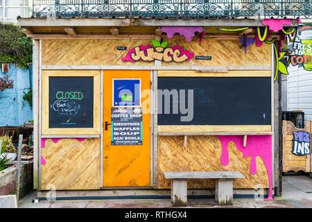 Margate seaside resort. Boarded coffee shop during the winter, off season time. Wooden hut building with black boards in place of windows. - Stock Photo