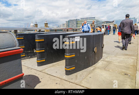 Anti-vehicle barriers erected on the pavement on London Bridge in the Borough area, Southwark London SE1 as a terrorism prevention measure - Stock Photo