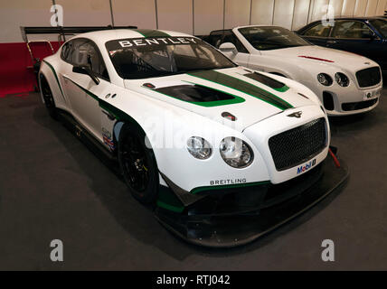 Three-quarter front view of a 2017 Bentley Continental GT3, on display in the Paddock Area of the 2019 London Classic Car Show - Stock Photo