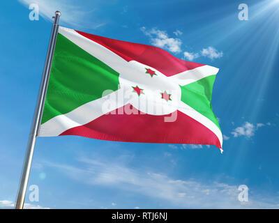 Burundi National Flag Waving on pole against sunny blue sky background. High Definition - Stock Photo