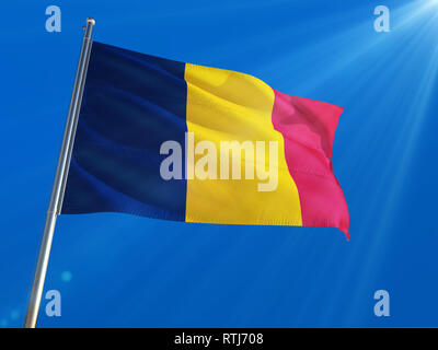 Chad National Flag Waving on pole against deep blue sky background. High Definition - Stock Photo