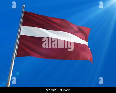 Latvia National Flag Waving on pole against deep blue sky background. High Definition - Stock Photo