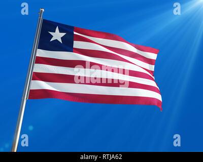 Liberia National Flag Waving on pole against deep blue sky background. High Definition - Stock Photo