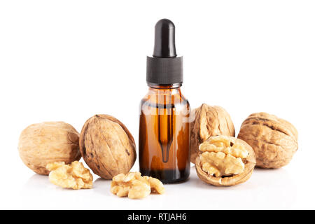 Walnut oil isolated on white background. walnut oil for Cosmetic or beauty care - Stock Photo