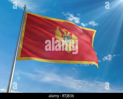 Montenegro National Flag Waving on pole against sunny blue sky background. High Definition - Stock Photo