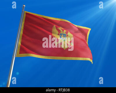 Montenegro National Flag Waving on pole against deep blue sky background. High Definition - Stock Photo
