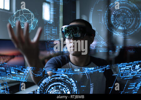 Men steps into virtual reality world with microsoft hololens 1 - Stock Photo