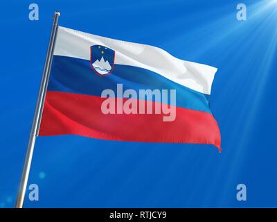 Slovenia National Flag Waving on pole against deep blue sky background. High Definition - Stock Photo