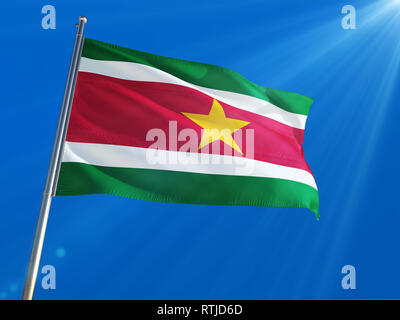 Suriname National Flag Waving on pole against deep blue sky background. High Definition - Stock Photo