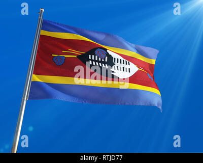 Swaziland National Flag Waving on pole against deep blue sky background. High Definition - Stock Photo