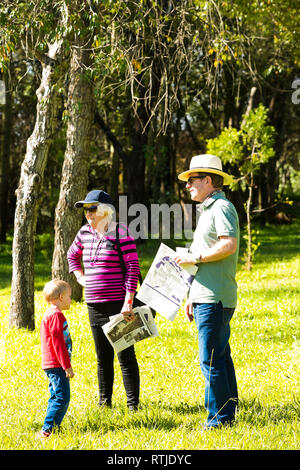 Johannesburg, South Africa - May 10 2014: Young Families at a park picnic - Stock Photo