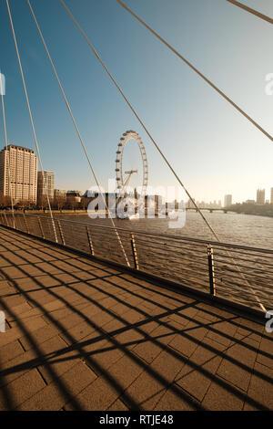 LONDON, UK, February 24, 2019: London Eye view from Golden Jubilee Bridge - Stock Photo