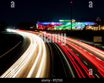 Augsburg, Germany- February 16 2019: View on WWK Arena the soccer stadion of FC Augsburg from highway bridge. Night image with long exposure. - Stock Photo
