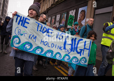 Glasgow, Scotland, 2 March 2019. The 'Blue Wave' demonstration by the Extinction Rebellion climate change group and supporters, blocking roads and moving through the streets of the city to highlight the rising waters of the River Clyde and to warn of the dangers of climate change if urgent action isn't taken immediately. The peaceful demonstration of approximately 200 people culminated with the symbolic throwing of water from the River Clyde on to the City Chambers steps, a symbol of the water levels to come. In Glasgow, Scotland. Credit: Jeremy Sutton-Hibbert/Alamy Live News. - Stock Photo