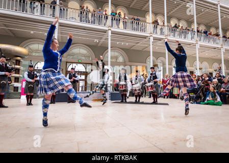 Edinburgh, UK. 2nd March 2019. Dancers and musicians perform at the Global Bagpipes event as part of the 10th Edinburgh Iranian Festival in the Grand Gallery of National Museum of Scotland, Edinburgh, Scotland. Iran and Scotland both share the bagpipe instrument and this performance highlighted the similarities and the many different styles and traditions. The Edinburgh Iranian Festival runs from Fri 1 - Fri 8 March 2019. Credit: Andy Catlin/Alamy Live News - Stock Photo