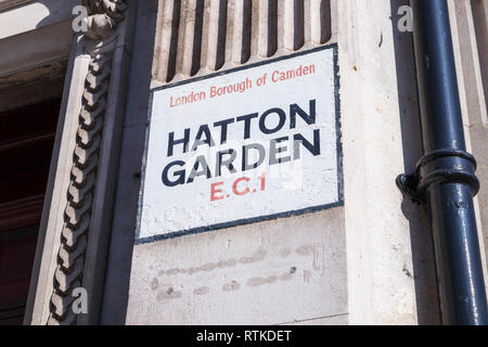 Painted street name sign at Hatton Garden, London Borough of Camden, EC1, London's jewellery quarter and centre of the UK diamond trade - Stock Photo
