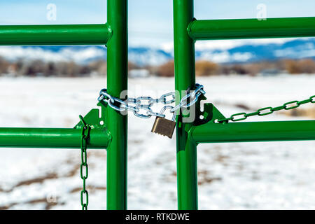 Ranch gate locked with padlock & chain; central Colorado; USA - Stock Photo
