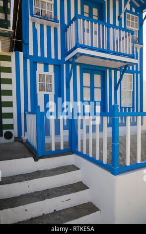 A blue and white house in Costa Nova, Aveiro, Portugal, Europe - Stock Photo