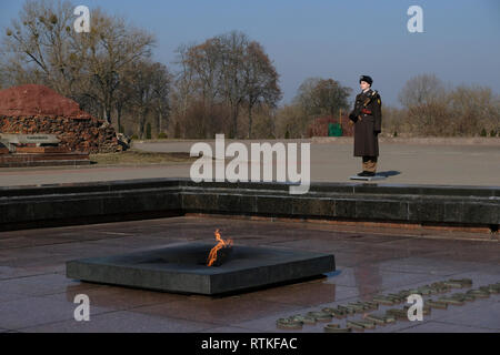 A Belarusian Guard of Honor stands firm next to the eternal fire in the war memorial complex 'Brest Hero Fortress' located in Brest fortress formerly known as Brest-Litovsk Fortress, a 19th-century Russian fortress in the city of Brest, Belarus - Stock Photo