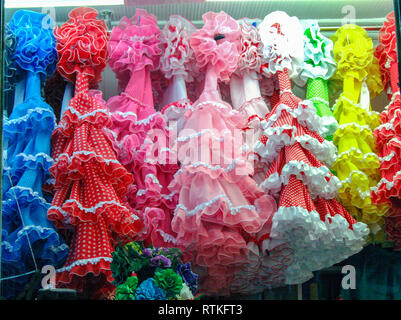 multicolored flamenco dresses in a shop window at Madrid, Spain - Stock Photo