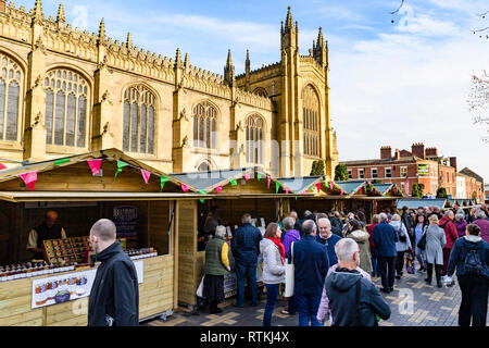 People shopping at busy Wakefield Food, Drink & Rhubarb Festival 2019, visiting market trade stalls & cathedral precinct - West Yorkshire, England, UK - Stock Photo