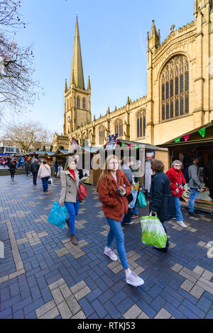 People shopping at Wakefield Food, Drink & Rhubarb Festival 2019, visiting market trade stalls in cathedral precinct - West Yorkshire, England, UK. - Stock Photo