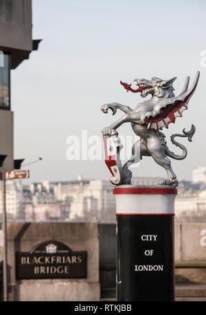 City of London,silver,Dragon,boundary,marker,entrance,on,south ,end,of,Blackfriars Bridge,cast,iron,statue,statues,London,England,English,UK,G.B., - Stock Photo