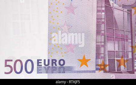 The back detail of the 500 Euro bill. It shows the image of a window or building and some stars - Stock Photo