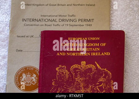 International Driving Permit and passport - Showing the 1968 and 1949 versions of the IDP which allow you to drive in certain countries in Europe use - Stock Photo
