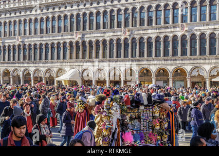 Venice, Italy crowd gathered for Venice Carnival at Saint Mark square. Large crowd waits to attend Venice Carnival 2019 parade at Piazza San Marco. - Stock Photo