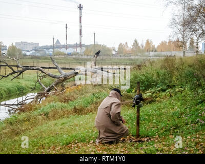 Stalker at the grave of another stalker. Stalker at the grave of another stalker. - Stock Photo