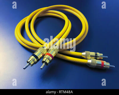 stereo audio extension yellow cable isolated on blue background - Stock Photo