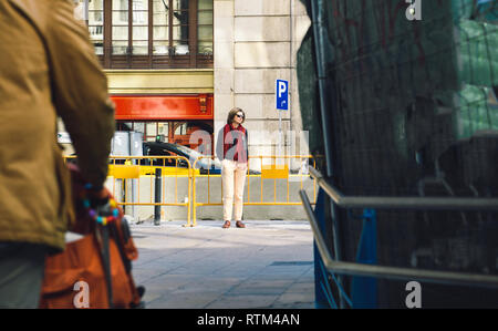 Silhouette of beautiful woman in central Barcelona - incognito wearing sunglasses  - Stock Photo