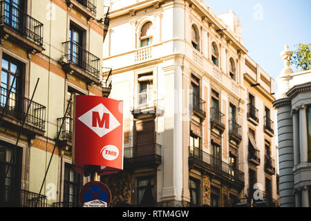 BARCELONA, SPAIN - NOV 12, 2017: Barcelona Metro sign entrance TMB public transportation with traditional architecture in the background - Stock Photo