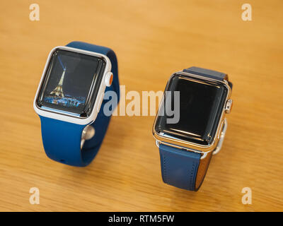 PARIS, FRANCE - SEP 22, 2017: New Apple Watch Series 3 goes on sale in Apple Store with Eiffel Tower screensaver timeface  - Stock Photo