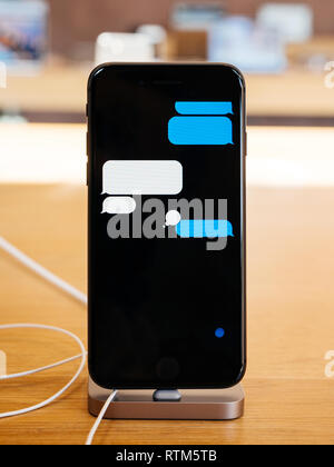 PARIS, FRANCE - SEP 22, 2017: New iPhone 8 and iPhone 8 Plus, as well the updated Apple Watch, Apple TV goes on sale today in Apple Store with customer  - Stock Photo