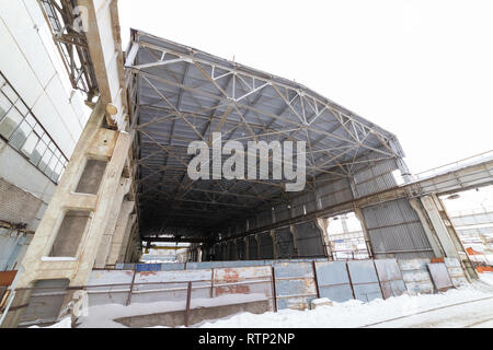 Industrial concept. An industrial empty construction. View from the outside - Stock Photo