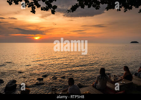 Koh Chang, Thailand - December 11, 2018: Tourists drink cocktails in sunset view bar on Koh Chang island. - Stock Photo