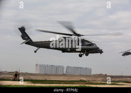 U.S. Army UH-60M Black Hawks assigned to Charlie Company, 3rd Battalion, 126th Aviation Regiment, transport U.S. Marines with India Company, 3rd Battalion, 4th Marine Regiment, and U.S. Sailors with shock trauma platoon, Combat Logistics Detachment 34, both attached to Special Purpose Marine Air-Ground Task Force Crisis Response-Central Command, during a casualty evacuation exercise in southwest Asia Feb. 12, 2019. The exercise provided an opportunity for the Marines, Sailors and Soldiers to practice a realistic scenario in which all three services contributed specialized life-saving skills on - Stock Photo