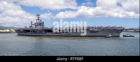 The USS John C. Stennis on August 5, 2016 in Pearl Harbor, USA. The John C. Stennis is a Nimitz class nuclear powered aircraft carrier. - Stock Photo