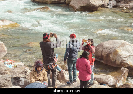 Teesta River front, Yumthang Valley, January 1 2019: Tourist people taking selfie too close to River after a recent news that group of teenager have d - Stock Photo